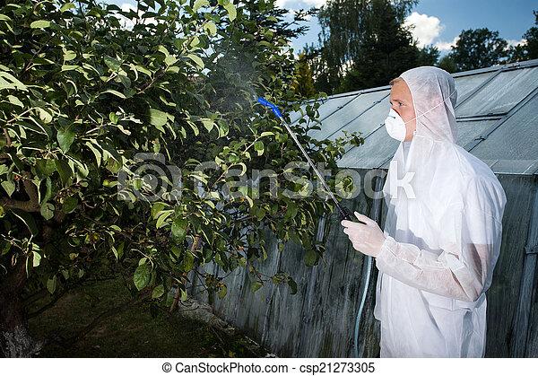 Gardener spraying trees - csp21273305