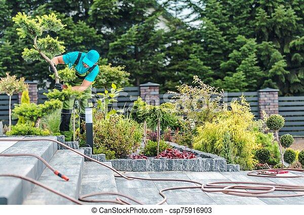Gardener Working in a Garden - csp75916903