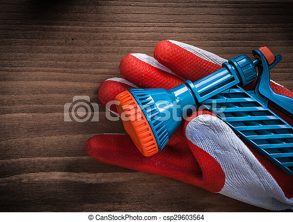 Gardening glove and water spray nozzle agriculture concept - csp29603564