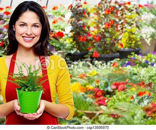 Gardening woman with plant. - csp13595970