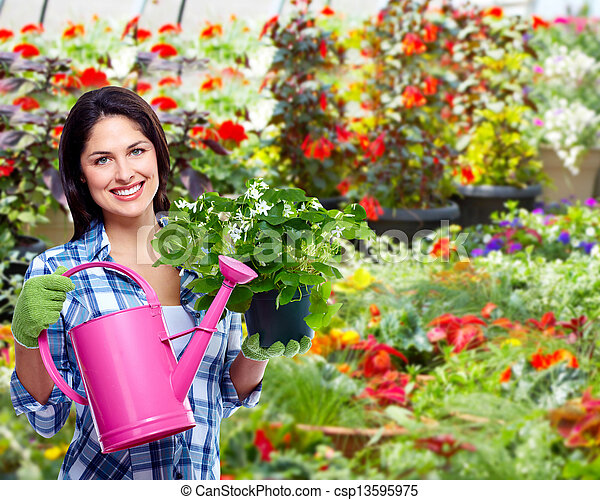 Gardening woman with plant. - csp13595975