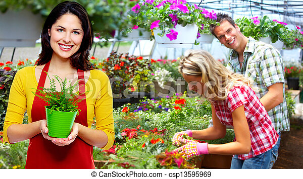 Gardening woman with plant. - csp13595969