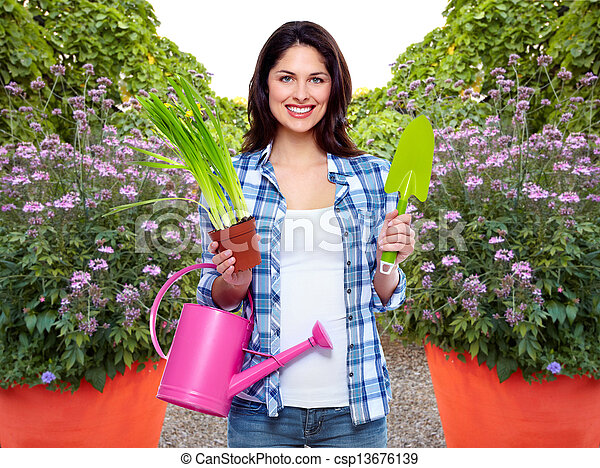 Gardening woman with plant. - csp13676139