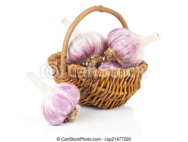 Garlic in a wicker basket, isolated on white background - csp21477220