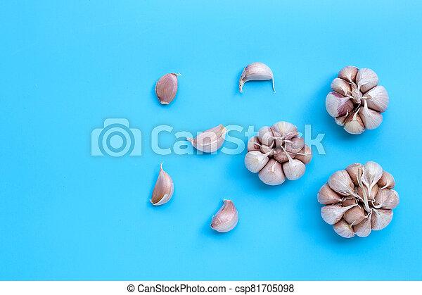 Garlic on blue background, top view - csp81705098