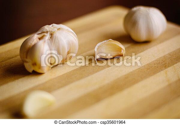 Garlic on the wooden background - csp35601964
