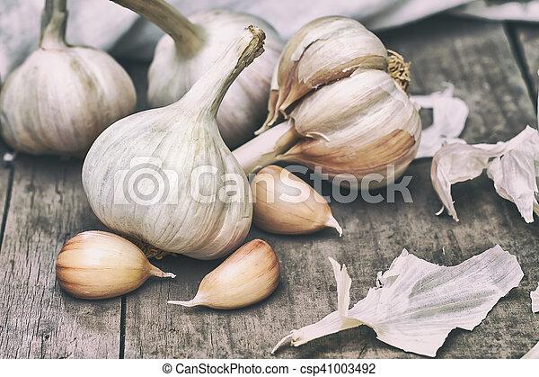 Garlic on wooden background - csp41003492