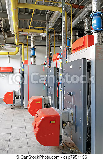 Gas boilers. Large boiler room with three gas boilers.