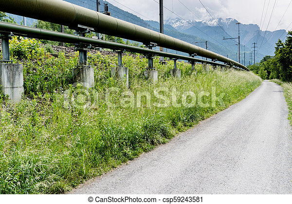 gas pipeline on the side of a country road in the Swiss Alps - csp59243581