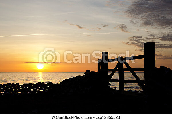 Gate in sunset - csp12355528