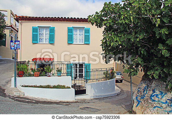 Gated Shuttered Home on a Narrow Street in Athens, Greece - csp75923306