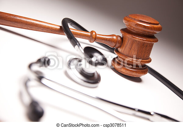 Gavel and Stethoscope on Gradated Background - csp3078511