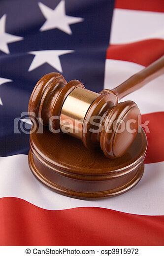 Gavel and the U.S. flag - csp3915972