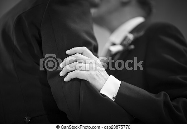 Gay lgbt same sex marriage wedding kiss - csp23875770