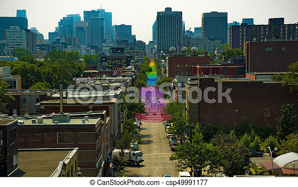 Gay pride festival on st-catherine street in Montreal, Canada - csp49991177
