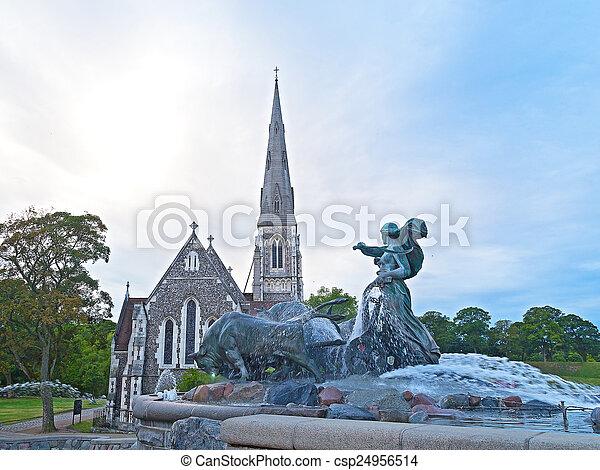 Gefion Fountain in Copenhagen. Gefion Fountain is near St. Alban's Anglican Church in Copenhagen, Denmark.  - csp24956514