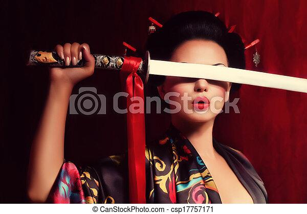 geisha in kimono with samurai sword - csp17757171
