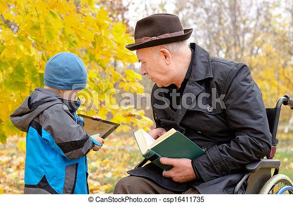 Generation gap between grandchild and grandfather - csp16411735