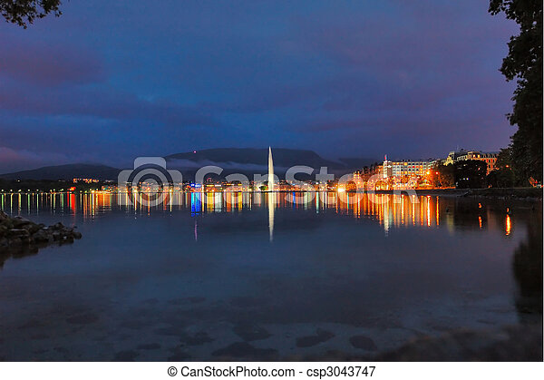Geneva Lake Front With The City Lights And The Jet D\u0027Eau In The Center.