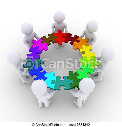 Gente sosteniendo piezas de rompecabezas conectadas en un círculo - csp17684342