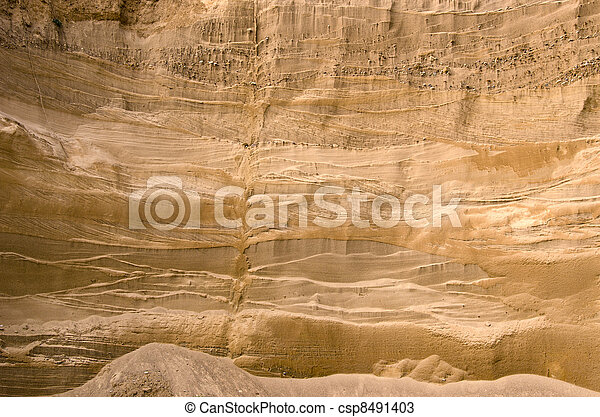 Geological layers of earth in deep sand pit  - csp8491403