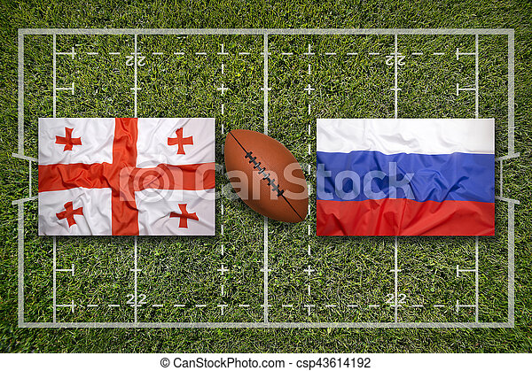 Georgia vs. Russia flags on green rugby field