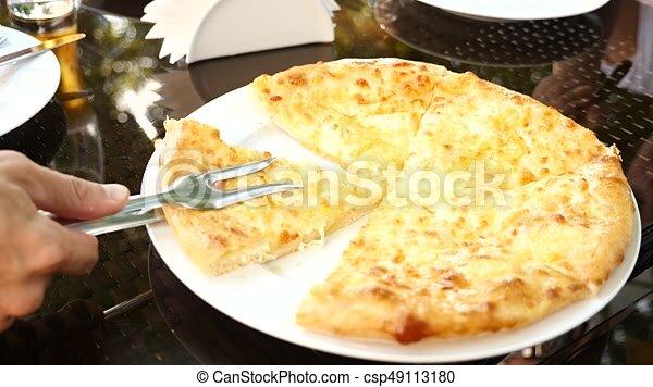 Georgian Khachapuri Megruli With Cheese Someone Takes A Piece Of Khachapuri From A Plate Slow Motion Georgian Khachapuri Canstock