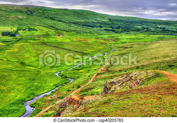 Geothermally active Haukadalur Valley in Iceland - csp40203763