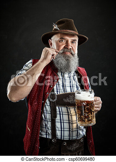 Germany, Bavaria, Upper Bavaria, man with beer dressed in in traditional Austrian or Bavarian costume - csp60699480