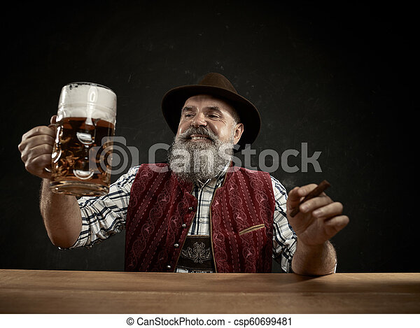 Germany, Bavaria, Upper Bavaria, man with beer dressed in in traditional Austrian or Bavarian costume - csp60699481