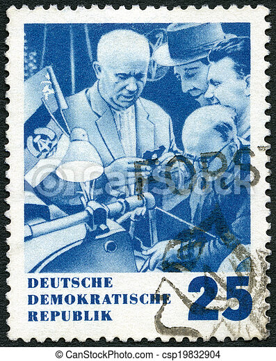 GERMANY - CIRCA 1964: A stamp printed in Germany shows Khrushchev and Inventors, Issued in honor of Premier Nikita S. Khrushchev of the Soviet Union, circa 1964 - csp19832904