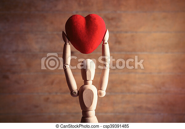 gestalta with heart-shaped toy - csp39391485