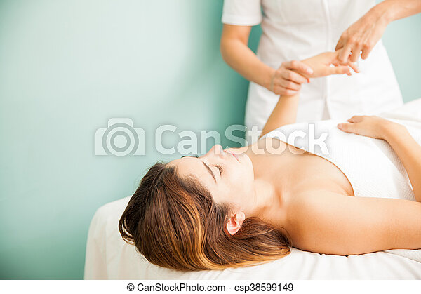 Getting a hand massage at the spa - csp38599149