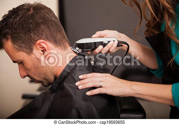 Getting haircut at a salon - csp19593655