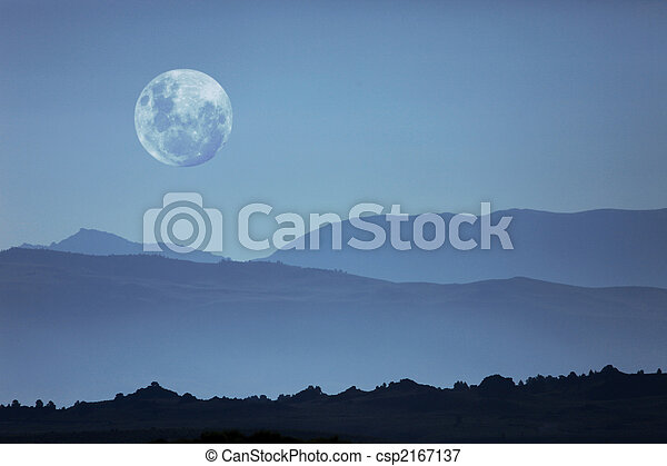 Ghostly Mountain Silhouettes and Moon - csp2167137