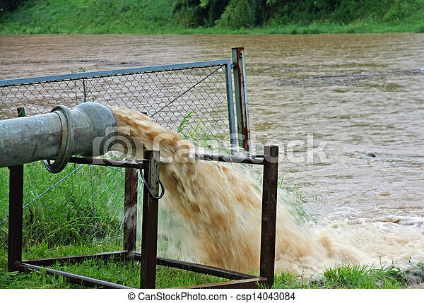 giant exhaust pipe pours into the muddy and Brown slurry - csp14043084