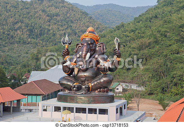 Giant Hindu God Ganesh on top of the building in a temple in Thailand - csp13718153