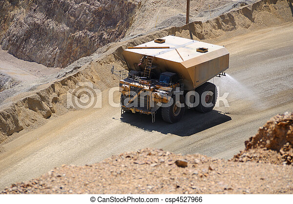 Giant Water Truck Supressing Dust at Copper Mine - csp4527966