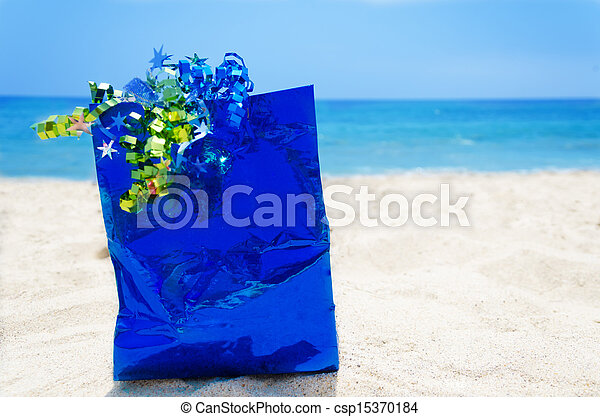 Gift bag on the beach - holiday concept - csp15370184
