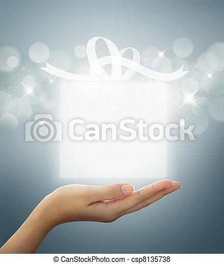gift box Translucent on woman hand  - csp8135738