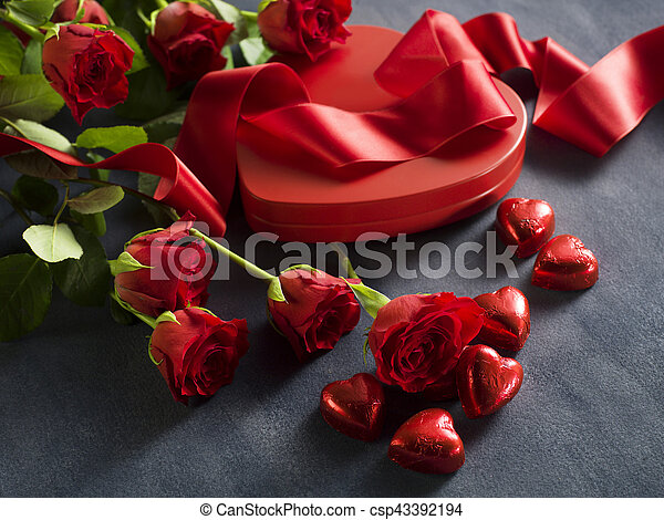 Gift box with a red ribbon on Valentine's Day - csp43392194