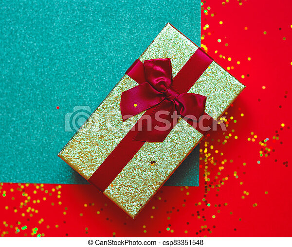 gift box with bow on red-green background - csp83351548