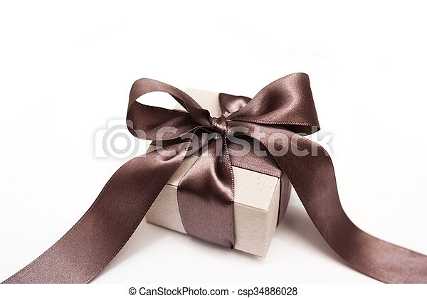 Gift box with brown bow on a white background - csp34886028