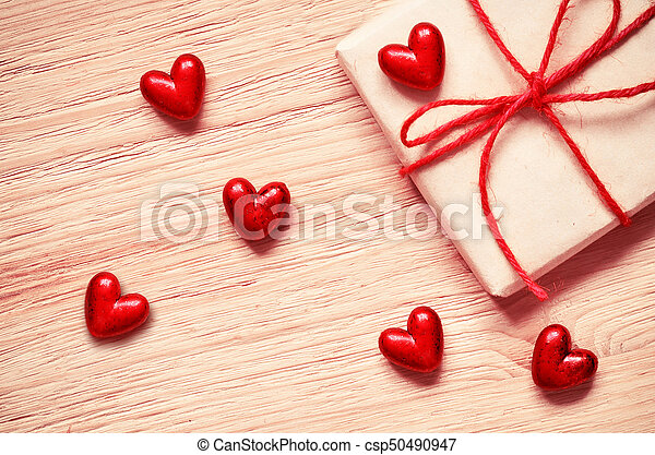 gift box with red hearts on a old wooden table. Valentine day. - csp50490947