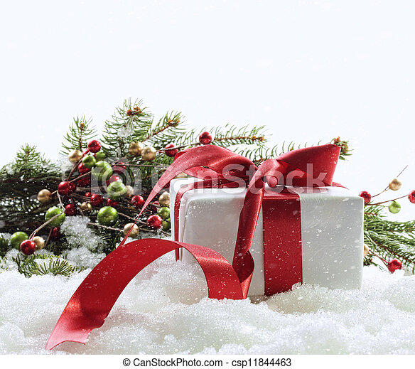 Gift box with red ribbon in snow on white - csp11844463