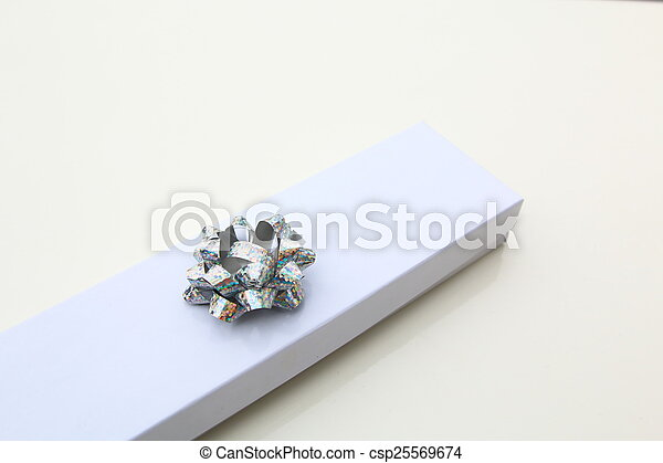 Gift box with silver ribbon bow isolated - csp25569674