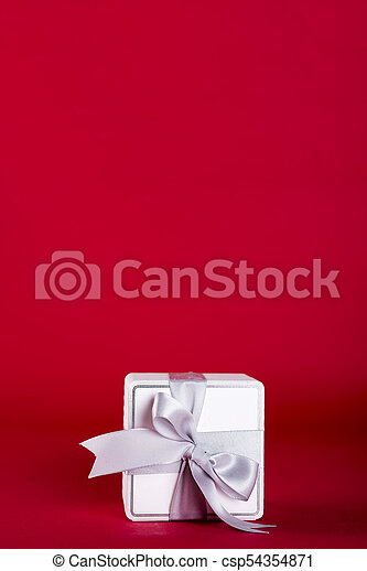 Gift box with silver ribbon bow - csp54354871