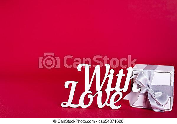 Gift box with silver ribbon bow - csp54371628