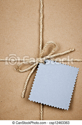 Gift with blue card in brown paper - csp12463363
