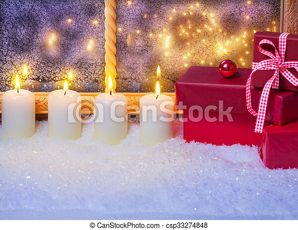 Gifts and candles in the window - csp33274848